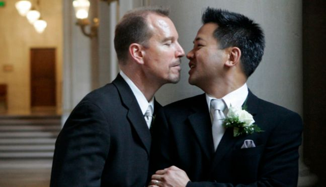 Same-sex couple Hata and Cadena share a private moment after their wedding ceremony in San Francisco